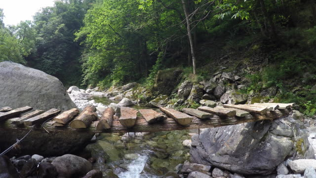 cross a river in the mountains - log stock videos and b-roll footage
