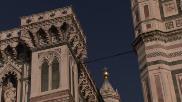 a cross adheres to a spire on a church in florence, italy. - spire stock videos & royalty-free footage