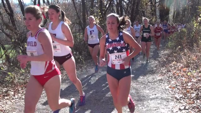 Cross Country Running women on trail in hills at Van Cortlandt Park in the Bronx