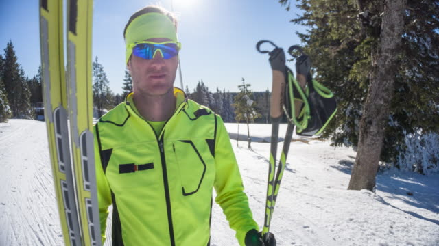 cross country skier carrying his sports equipment - carrying stock videos & royalty-free footage