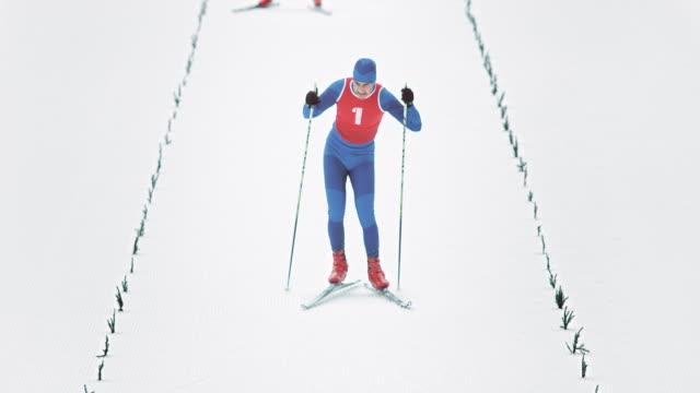slo mo cross country skier crossing the finish line - pokljuka stock videos and b-roll footage