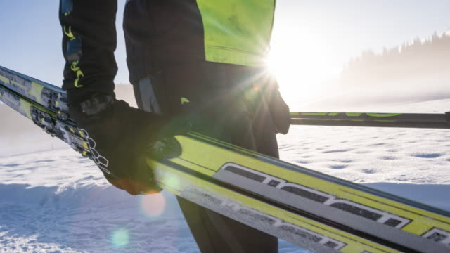 cross country skier in winter landscape carrying his sports equipment - winter sport stock videos and b-roll footage
