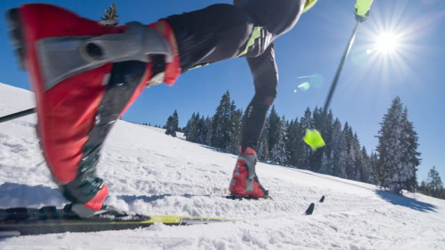 cross country skier on a parallel grooved ski track - gliding stock videos and b-roll footage