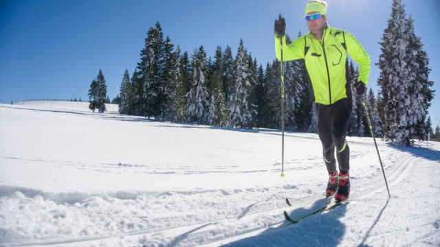 Cross country skier on a parallel grooved ski track