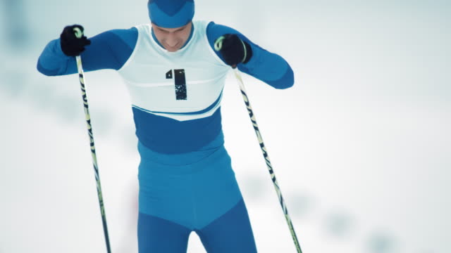 slo mo cross country skier on the track - pokljuka stock videos and b-roll footage