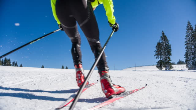 cross country skier skate skiing uphill - ski holiday stock videos & royalty-free footage