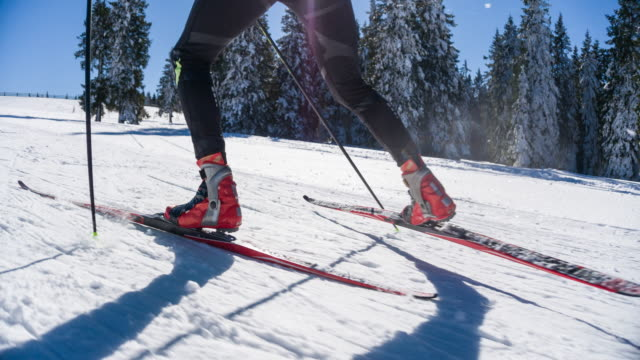 cross country skier skate skiing uphill, warming up - ski stock videos & royalty-free footage
