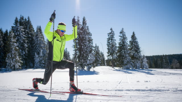 Cross country skier warming up and stretching before the race