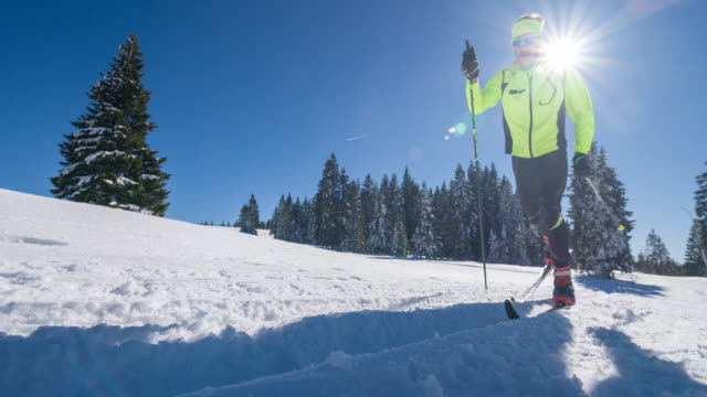 cross country skiing on a parallel grooved ski track - striding stock videos & royalty-free footage