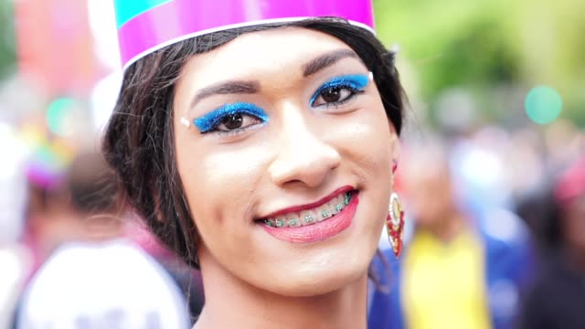 cross dressing man wearing the clothing of woman gender figures - intersex stock videos and b-roll footage