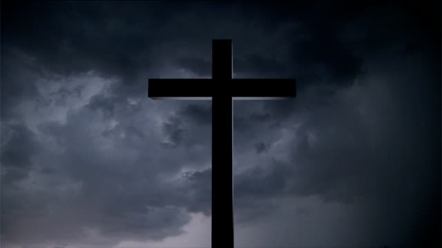 cross illuminated by thunderstorm - religion stock videos and b-roll footage