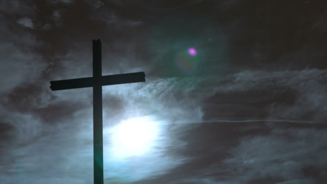 cross in front of blue sky (pan and tl) - religious cross stock videos and b-roll footage