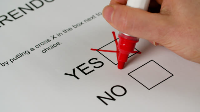 cross marked next to 'yes' on referendum paper - booth stock videos & royalty-free footage
