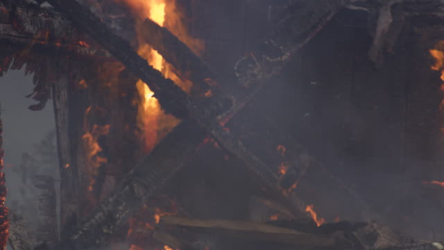 a cross of charred wood is consumed by the flames of a burning house - myrtle creek stock videos & royalty-free footage