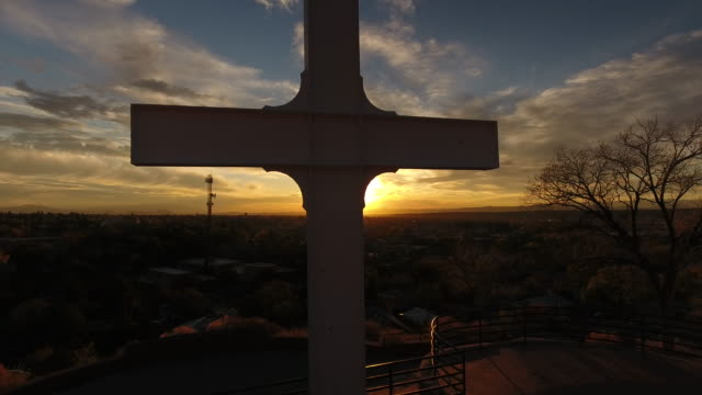 Cross of the Martyrs at Fort Marcy Santa Fe New Mexico shot at sunset over looking the Capital City of Santa Fe