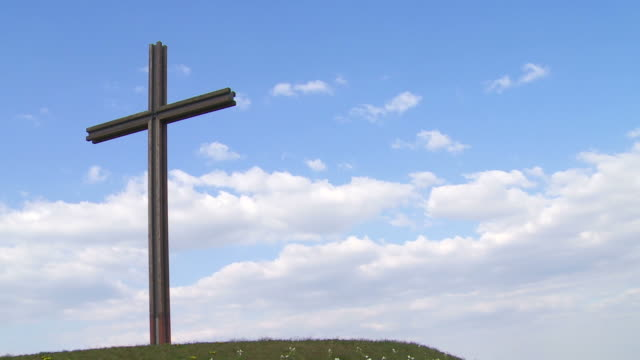 t/l cross on a hill in spring - textfreiraum stock videos & royalty-free footage
