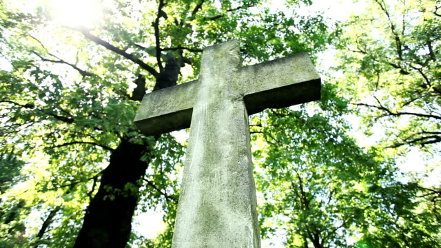cross on cemetery with sunlight - covering stock videos and b-roll footage