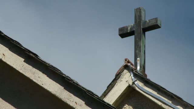 cross on church roof - chapel stock videos & royalty-free footage