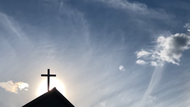 cross on church with clouds and sun - resurrection religion stock videos & royalty-free footage