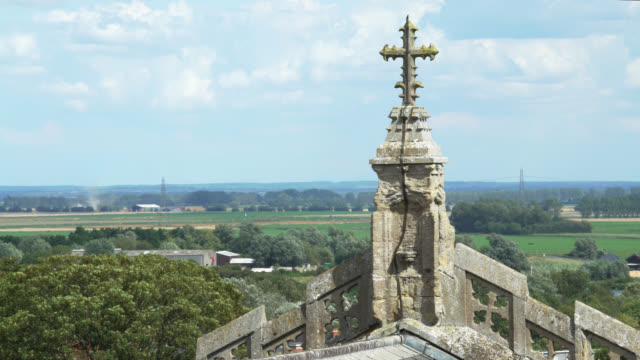 cross on ely cathedral overlooking countryside - religious equipment stock videos & royalty-free footage