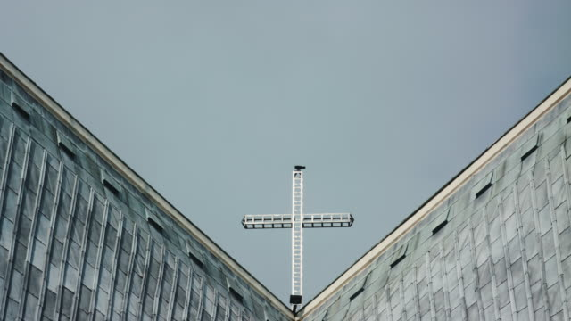 Cross On Top Of Church Against Clear Sky