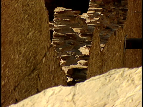 a cross section of stone walls remains among the ruins of pueblo-bonito in chaco canyon. - chaco canyon stock videos & royalty-free footage