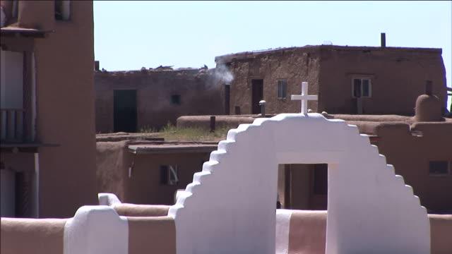a cross tops a white doorway. - adobe bildbanksvideor och videomaterial från bakom kulisserna
