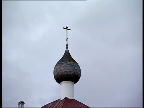 a cross tops an onion-shaped dome at solovetsky monastery. - onion dome stock videos and b-roll footage