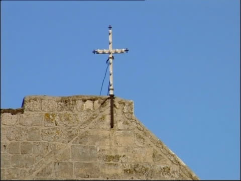 A cross towers above the Church of the Nativity in Bethlehem.