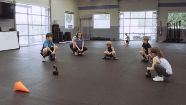 cross training class for children - school bell stock videos and b-roll footage
