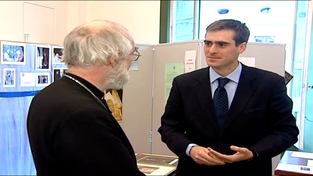 ba cross wearing employee backed by archbishop of canterbury italy rome green with archbishop of canterbury dr rowan williams face of dr williams... - カンタベリー大主教点の映像素材/bロール