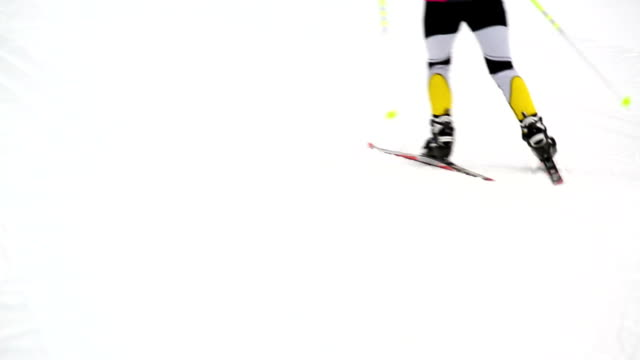 cross-country skier on track medium shot - nordic skiing event stock videos and b-roll footage
