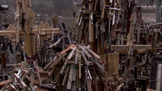 Crosses and crucifixes bundled together en mass at the Hill of Crosses. Available in HD.