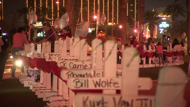 crosses outside the mandalay bay resort and casino in las vegas to remember victims of the las vegas mass shooting - shooting a weapon stock videos & royalty-free footage