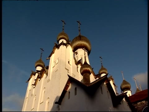 crosses top the onion domes of a church in moscow. - onion dome stock videos and b-roll footage