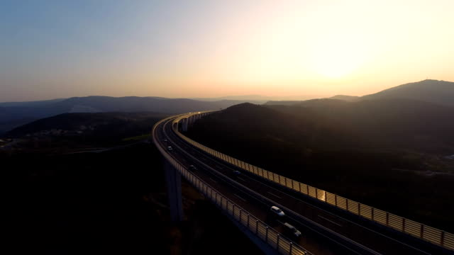 hd heli: crossing a viaduct at sunset - major road stock videos & royalty-free footage