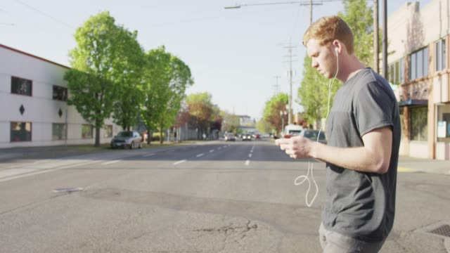 crossing busy street while distracted by phone - oblivious stock videos & royalty-free footage