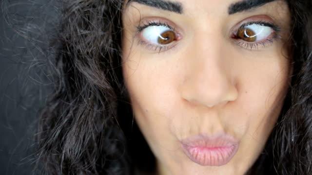 Crossing eyes woman