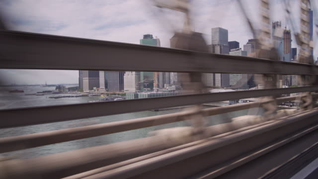 crossing over the brooklyn bridge viewing downtown manhattan and the east river. - east river stock videos & royalty-free footage