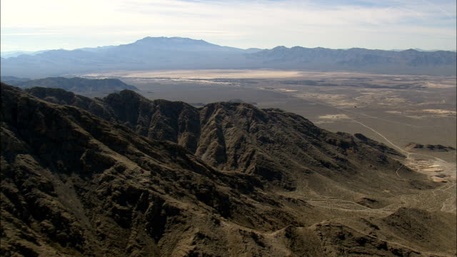 crossing spring mountains  - aerial view - nevada,  clark county,  united states - clark county nevada stock videos & royalty-free footage