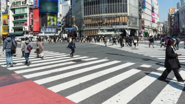 crossing street at shibuya tokyo - chaos stock videos & royalty-free footage