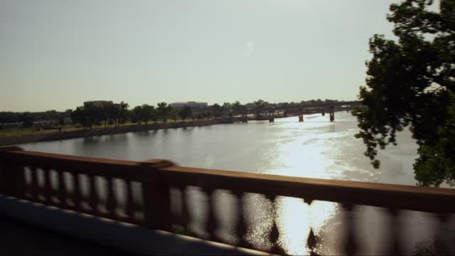 crossing the arkansas river on a bridge at sunset - arkansas stock videos & royalty-free footage
