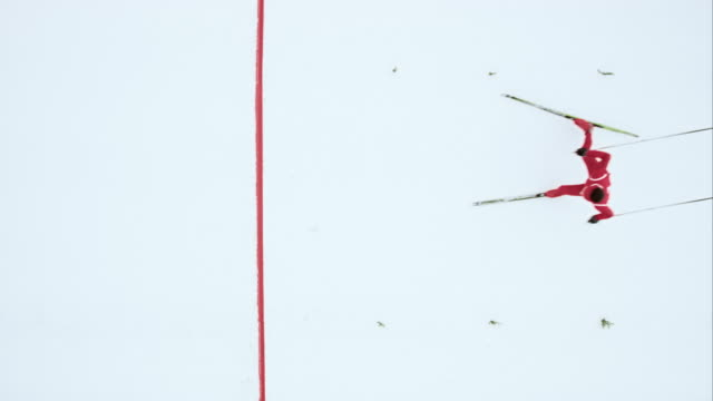 slo mo crossing the finish line in a biathlon race - biathlon stock videos and b-roll footage