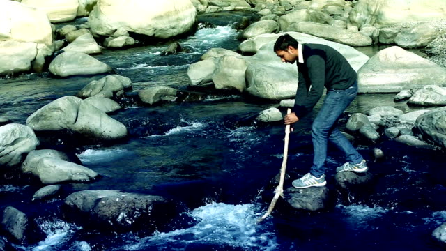 crossing the river with walking stick - stepping stone stock videos & royalty-free footage