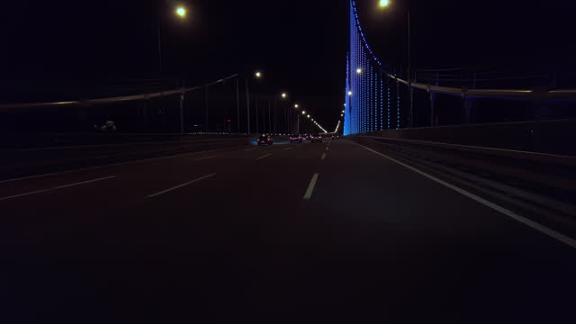crossing the xing hai bay bridge at night. - low angle view stock videos & royalty-free footage