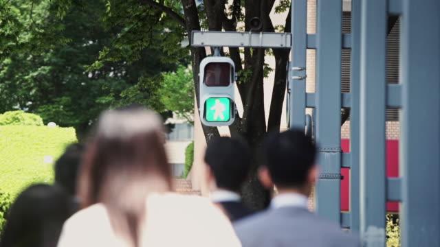 crossing tokyo street - road signal stock videos & royalty-free footage