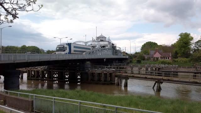 crosskeys swing bridge spans the river nene at sutton bridge linclonshire england. - waterfront stock videos & royalty-free footage
