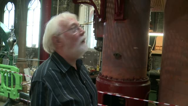 crossness pumping station volunteers in period clothes working with machinery in museum machinery turning mike jones set up shot with reporter /... - pumping station stock videos & royalty-free footage