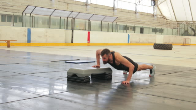 crossover push ups and jump lunges with aerobic stepper, handheld shot - jump shot stock videos and b-roll footage
