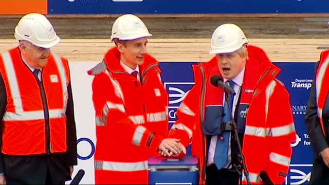 canary wharf station under construction lib / tx boris johnson standing next to lord adonis as counting down and pressing button sot crane lowering... - lowering stock videos & royalty-free footage